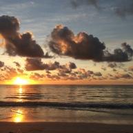 Zanzibar sun cresting the coral horizon